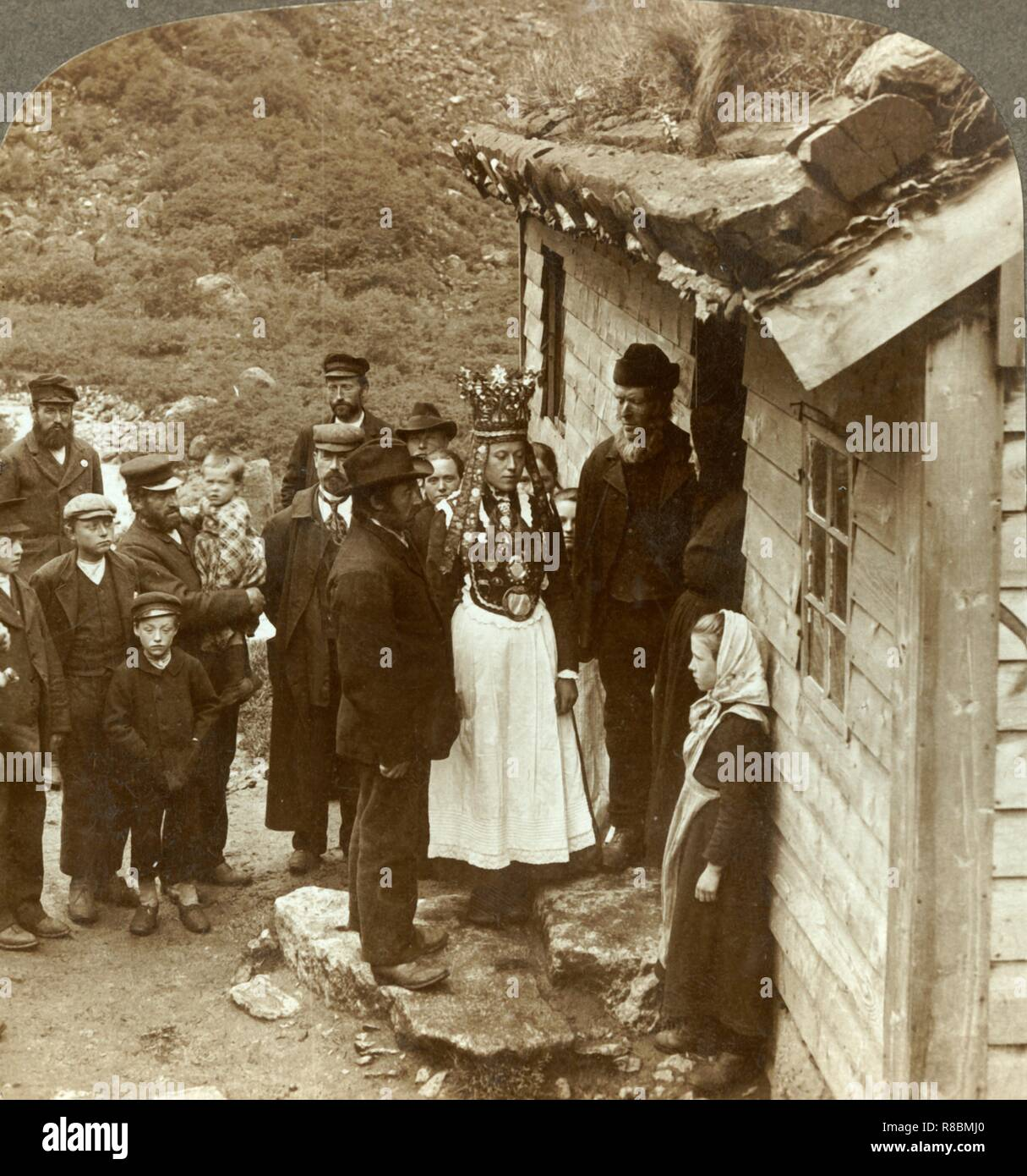 "'A Nordfjord bride and groom with guests and parents at their house door, Brigsdal, Norway', c1905. From ""The Underwood Travel Library - Norway"". [Underwood & Underwood, London ] - Stock Image"