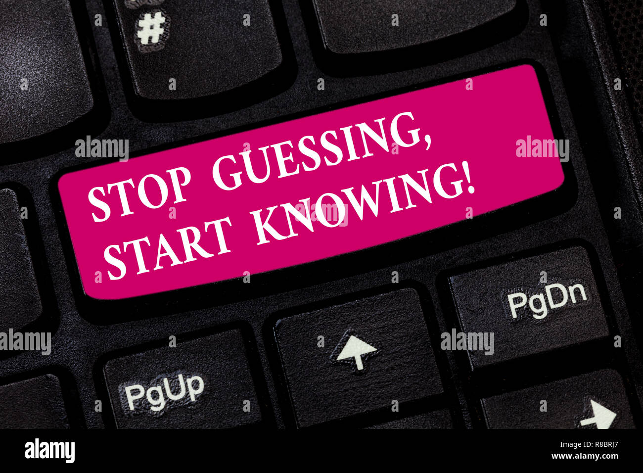 Conceptual hand writing showing Stop Guessing Start Knowing. Business photo showcasing Do not guess get the knowledge to be sure Keyboard key Intentio - Stock Image