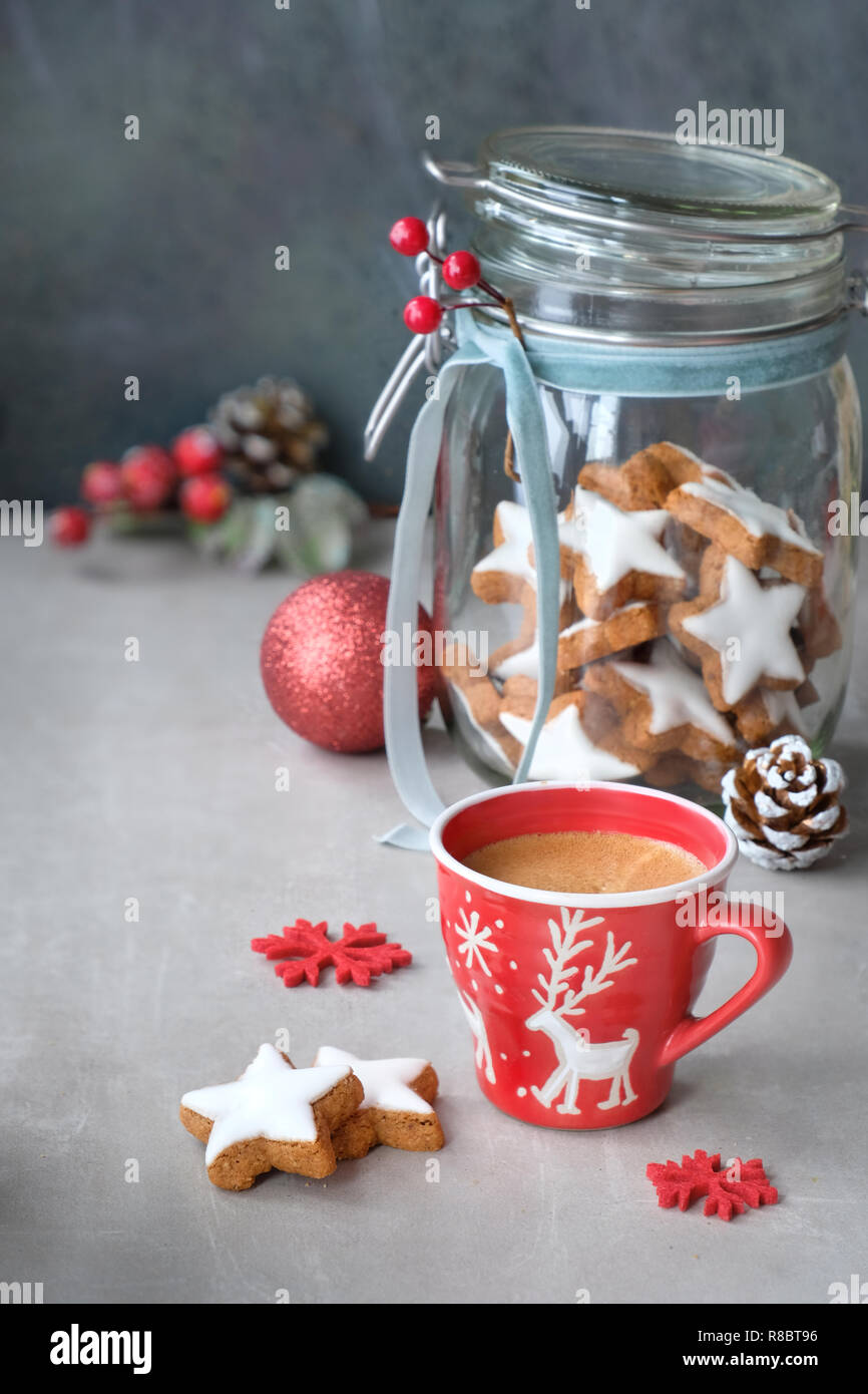 Christmas Background With Coffee In Red Xmas Cup And Tasty Star Ginger Cookies In A Glass Jar With Winter Decorations Stock Photo Alamy