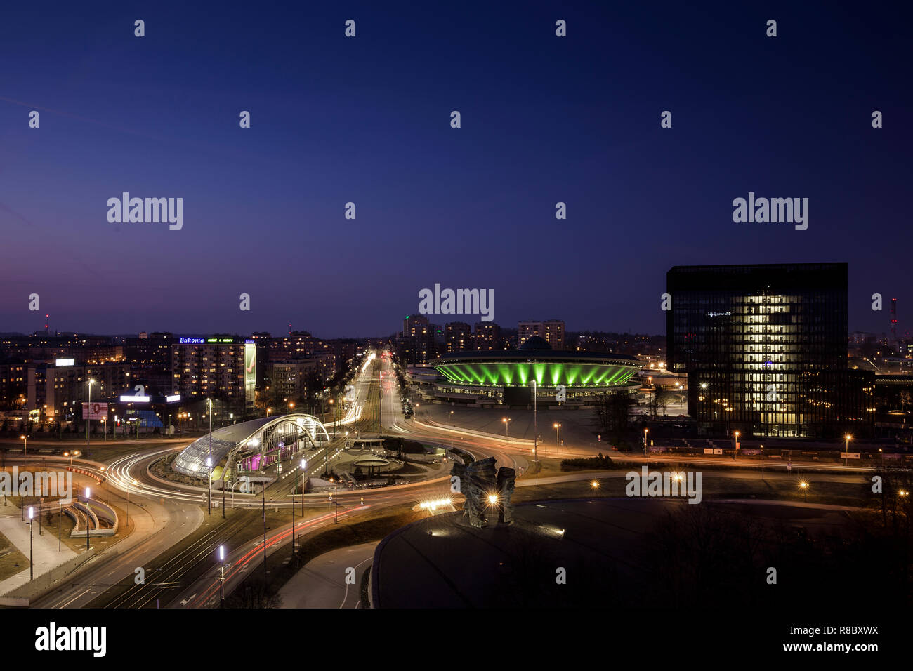 Silesian metropolis Katowice in Poland at night with spodek @ blue hour and clear blue sky; nice view from the rooftop of Hotel Katowice Stock Photo