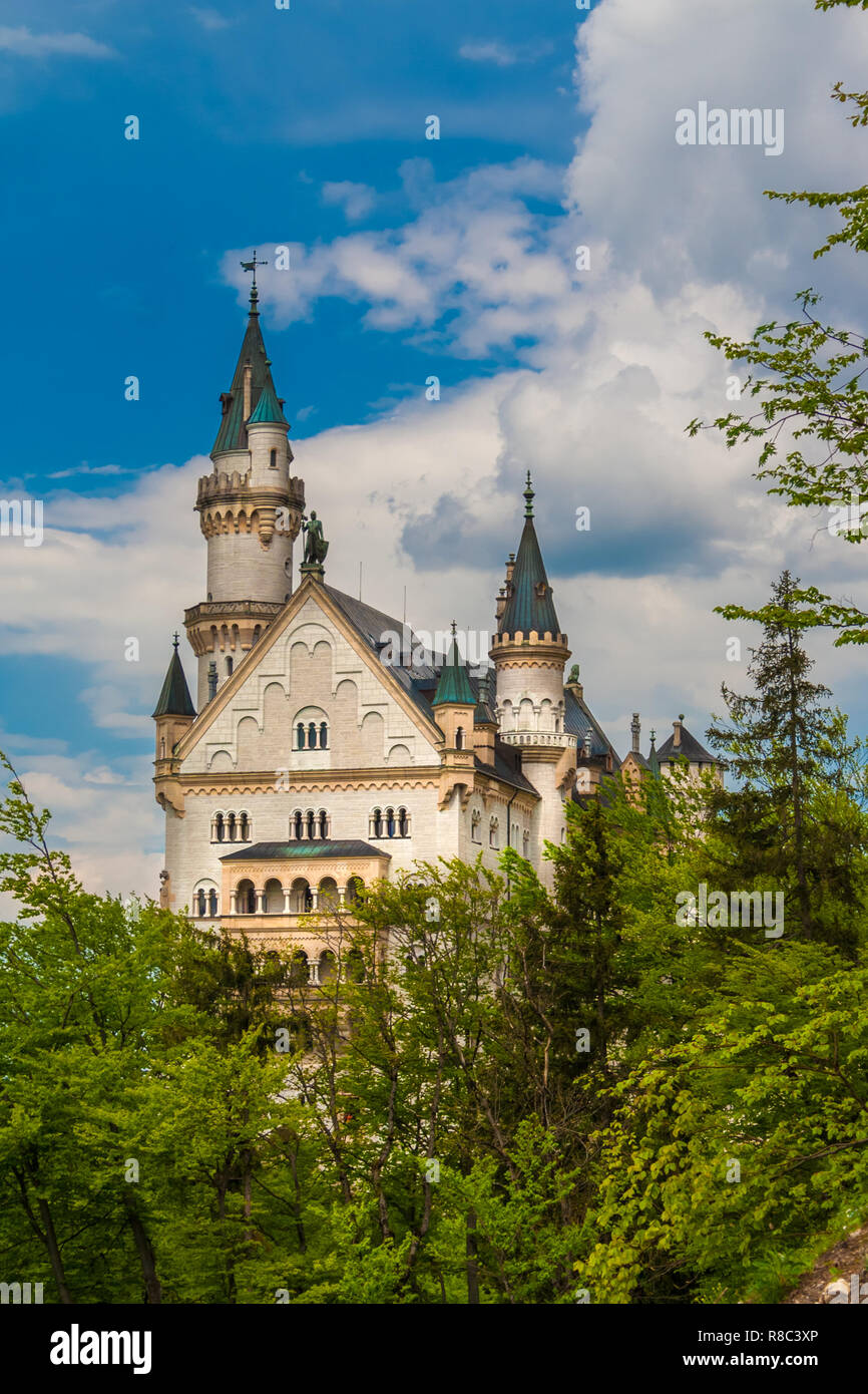 Romantic view of the beautiful west façade of the famous Neuschwanstein Castle, a Romanesque Revival palace at the village of Hohenschwangau near... - Stock Image
