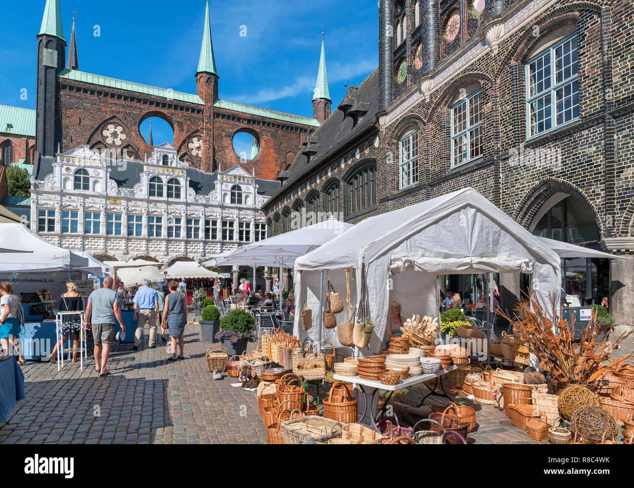 Sunday market in front of the historic 13th century Rathaus (Town Hall), Markt, Lubeck, Schleswig-Holstein, Germany - Stock Image