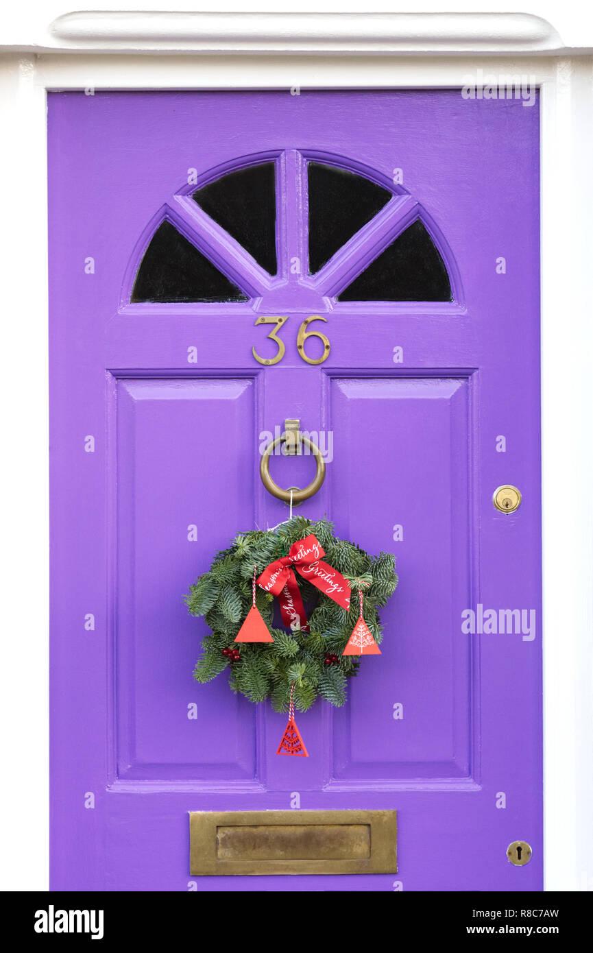 Christmas Wreath On Purple Door Stock Photos Christmas Wreath On