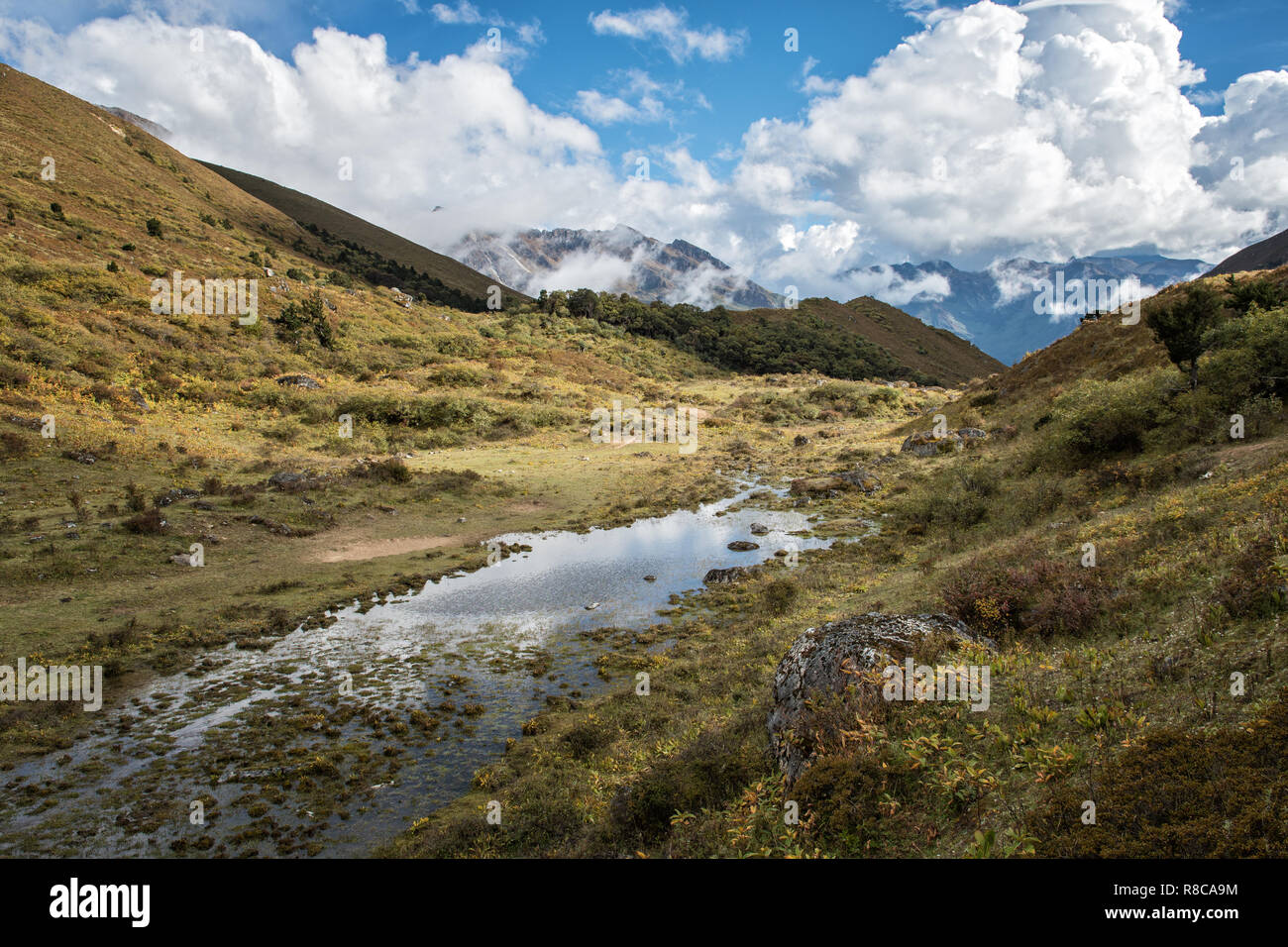 Pond and mountains at Robluthang, Gasa District, Snowman Trek, Bhutan - Stock Image