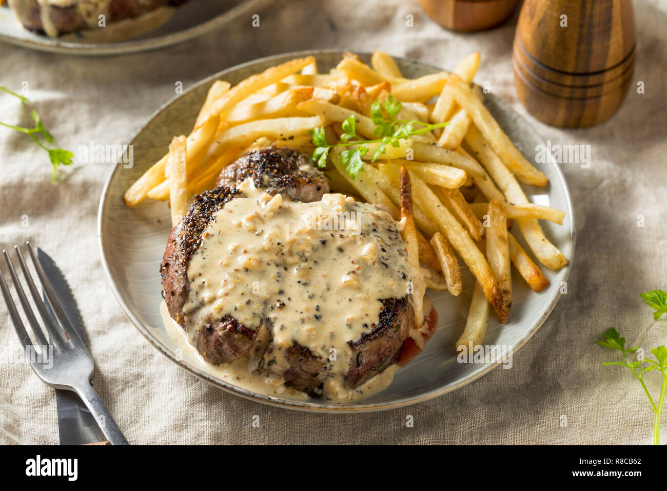 Homemade Steak Au Poivre with Pepper Sauce Stock Photo