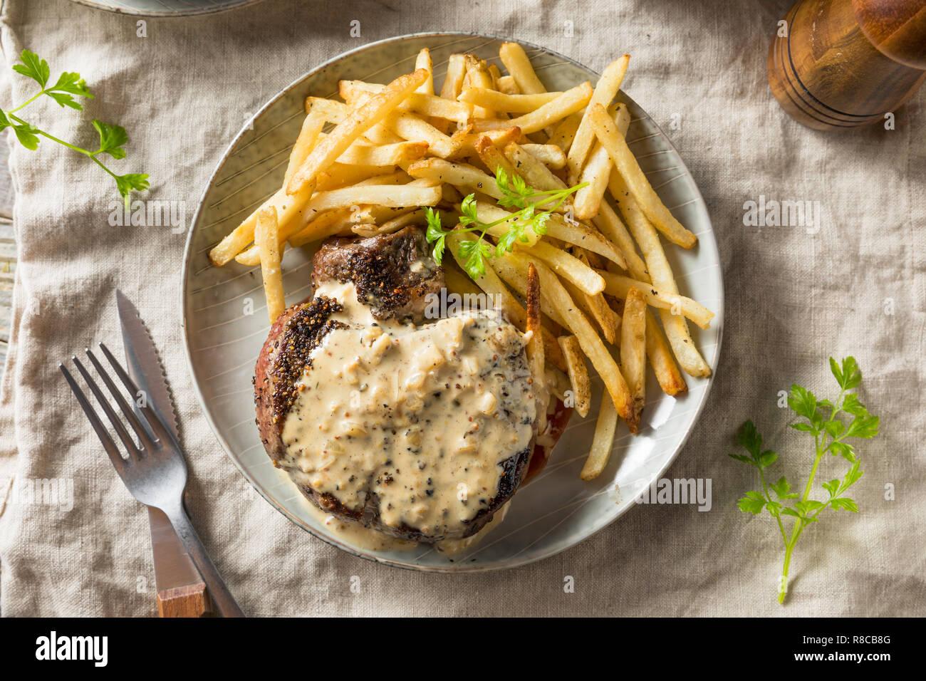 Homemade Steak Au Poivre with Pepper Sauce Stock Photo