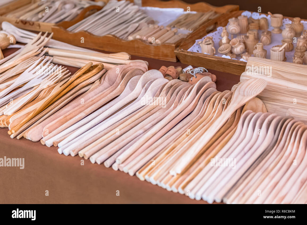 Wooden kitchen utensils, in traditional market... - Stock Image