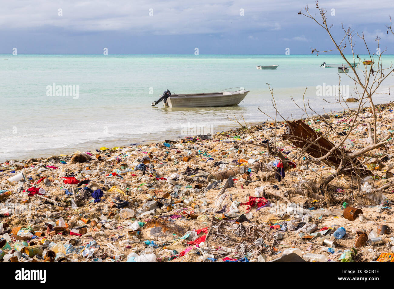Garbage dump, landfill, Micronesian atoll sand beach, South Tarawa, Kiribati, Oceania. Ecological and garbage management problems of island nations. - Stock Image