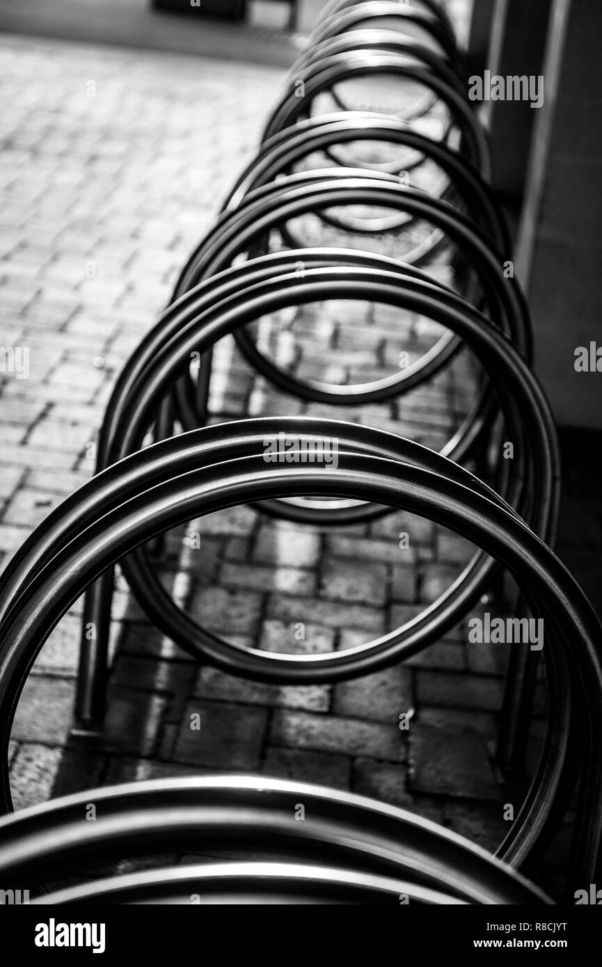 Unusual bike rack in pedestrian precinct in Bradford on Avon, Wiltshire, UK. - Stock Image