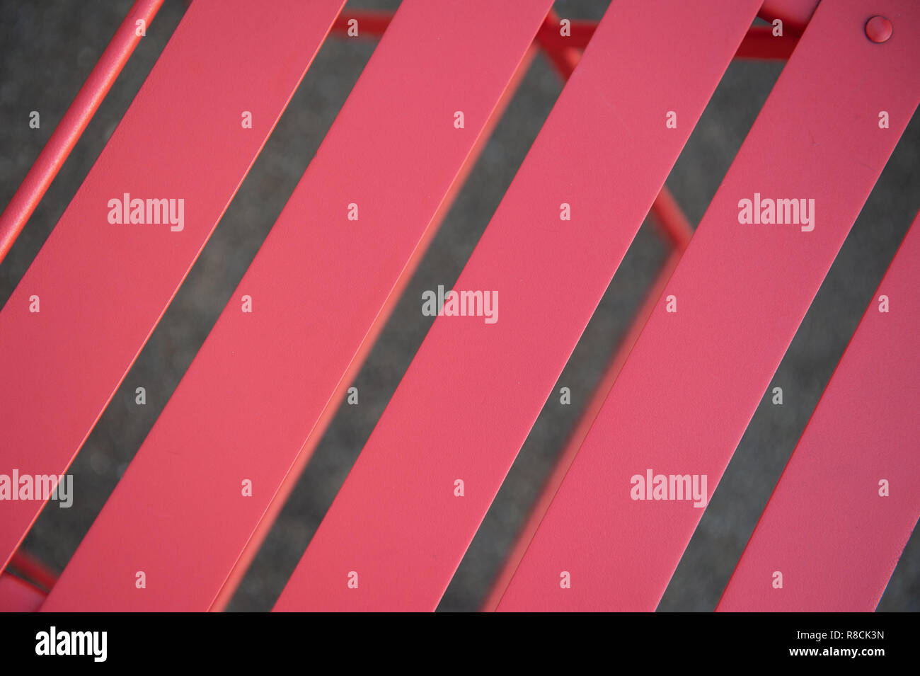 Slats on seat of cafe style chair. - Stock Image