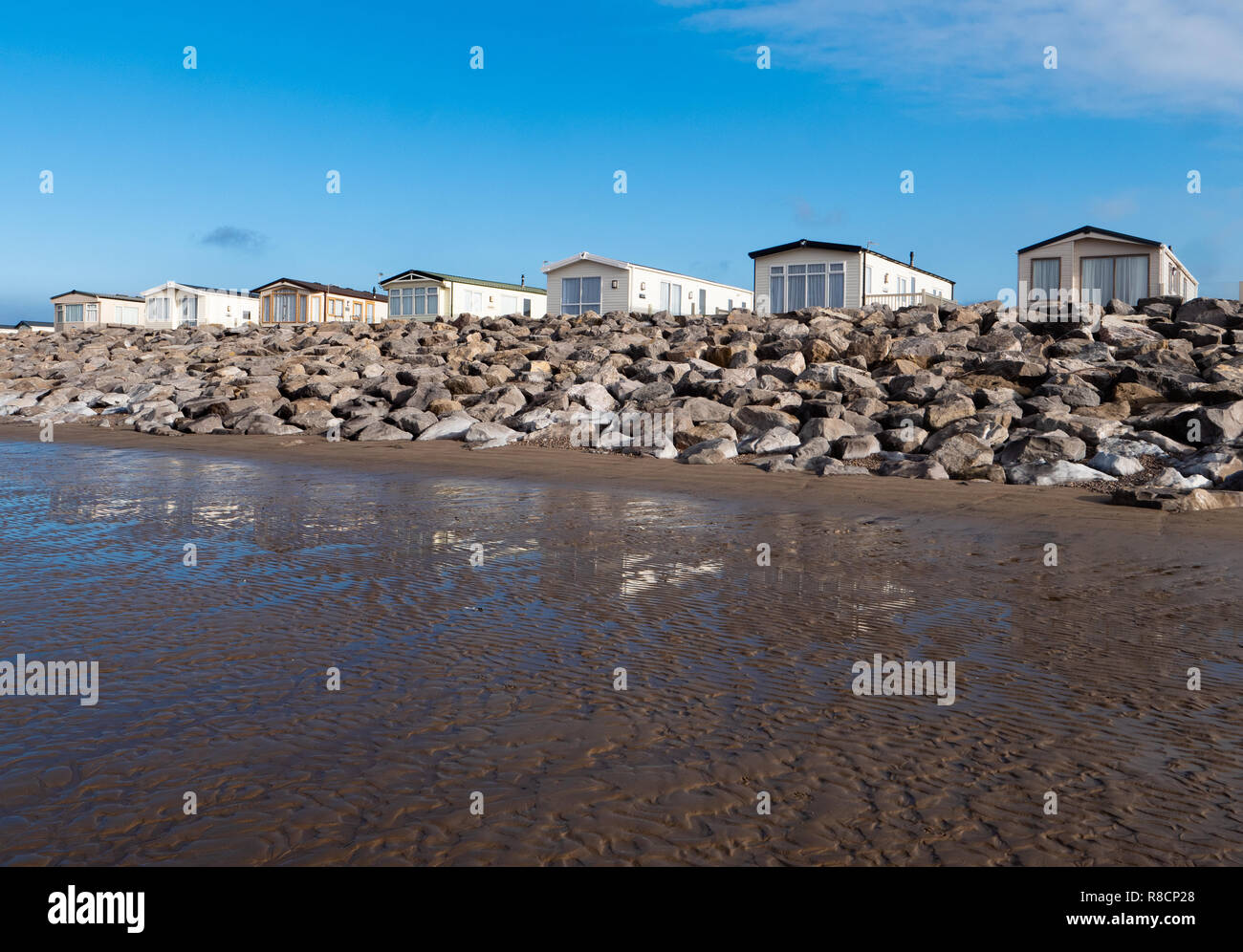 Static caravans fronting the beach near Brean Down in Somerset UK - Stock Image
