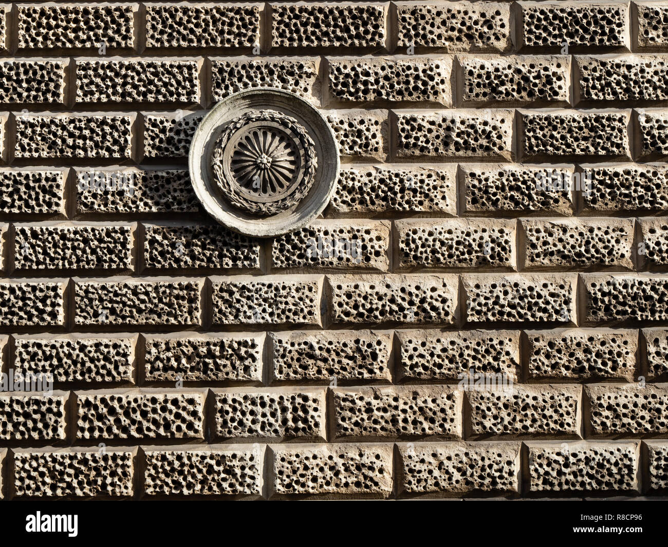 Rusticated Bath stone and sculpted roundel on the walls of a building in the city of Bath Somerset UK - Stock Image