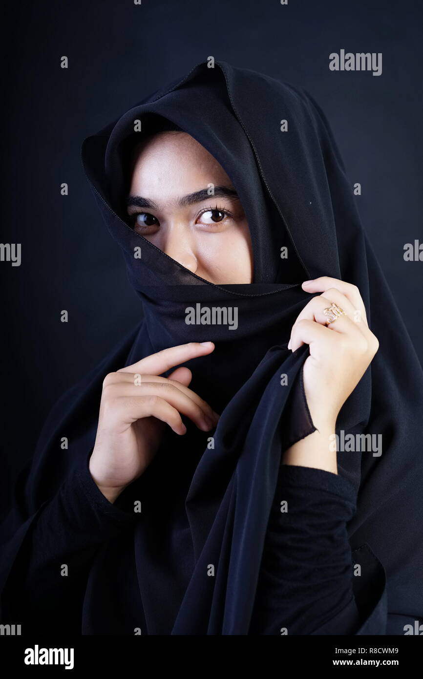 Beautiful Muslim woman wearing a burka - Stock Image