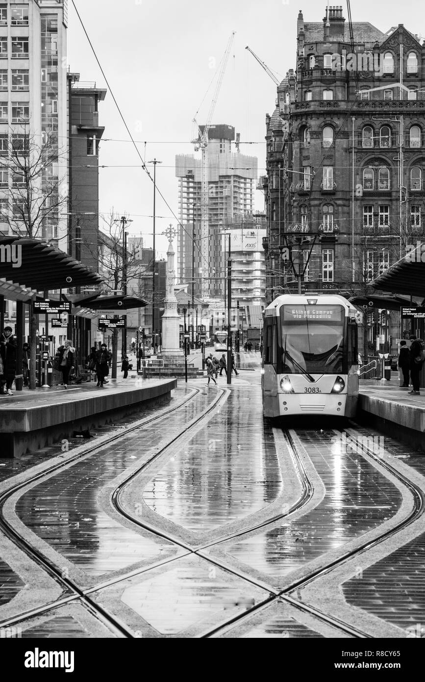 Black and White atmospheric image of the tram tracks on St Peter's Sq Manchester UK - Stock Image