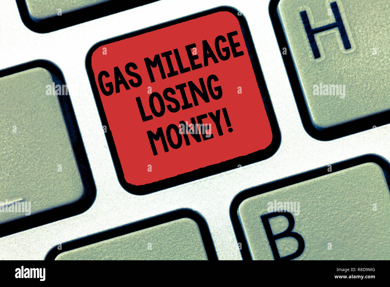 Writing note showing Gas Mileage Losing Money. Business photo showcasing Long road high gas fuel costs financial losses Keyboard Intention to create c Stock Photo