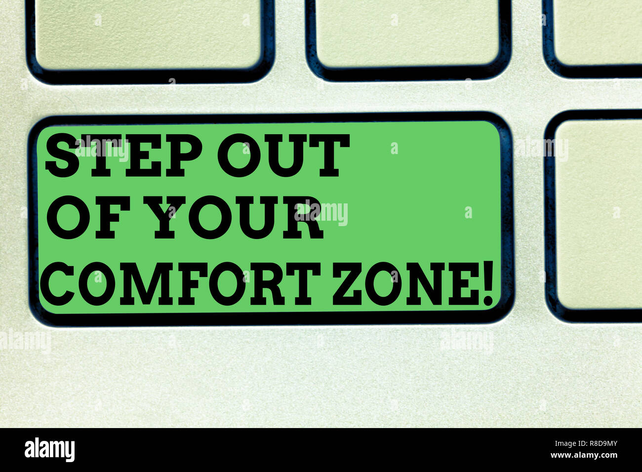 Writing note showing Step Out Of Your Comfort Zone. Business photo showcasing Do different things leave the routine Keyboard key Intention to create c Stock Photo