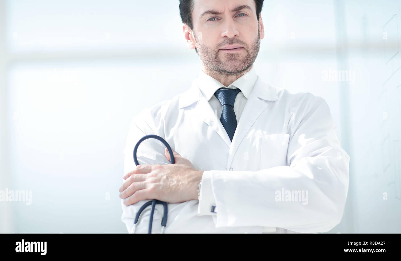 close up.brooding doctor on blurred background of the hall - Stock Image