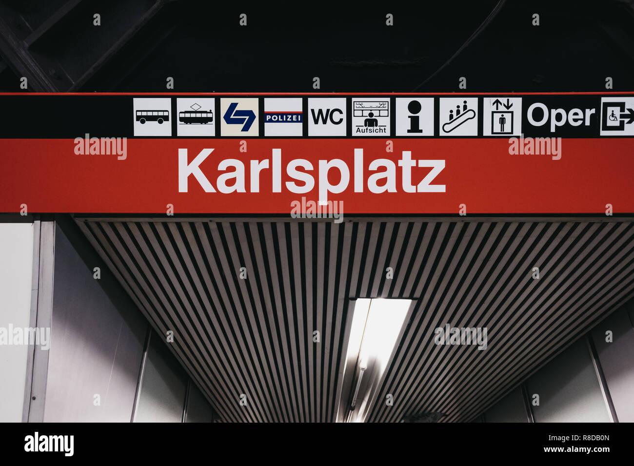 Vienna, Austria - November 25, 2018: Station name sign and directions inside Karlsplatz station in Vienna. Vienna public transport, Wiener Linien, ope - Stock Image
