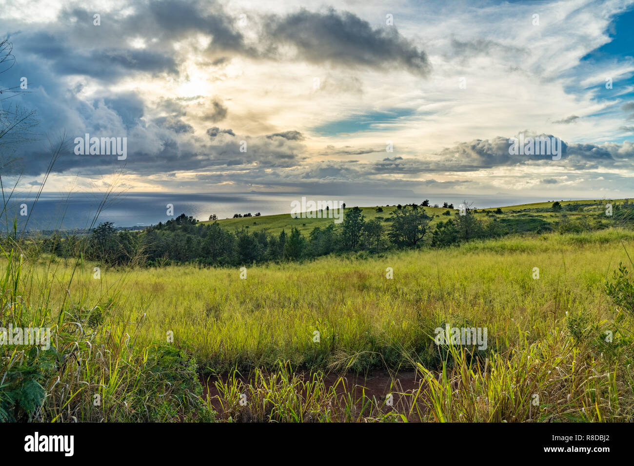 Dramatic clouds over the ocean, looking west from the first pull out on highway 550, Waimea, Kauai, Hawaii - Stock Image