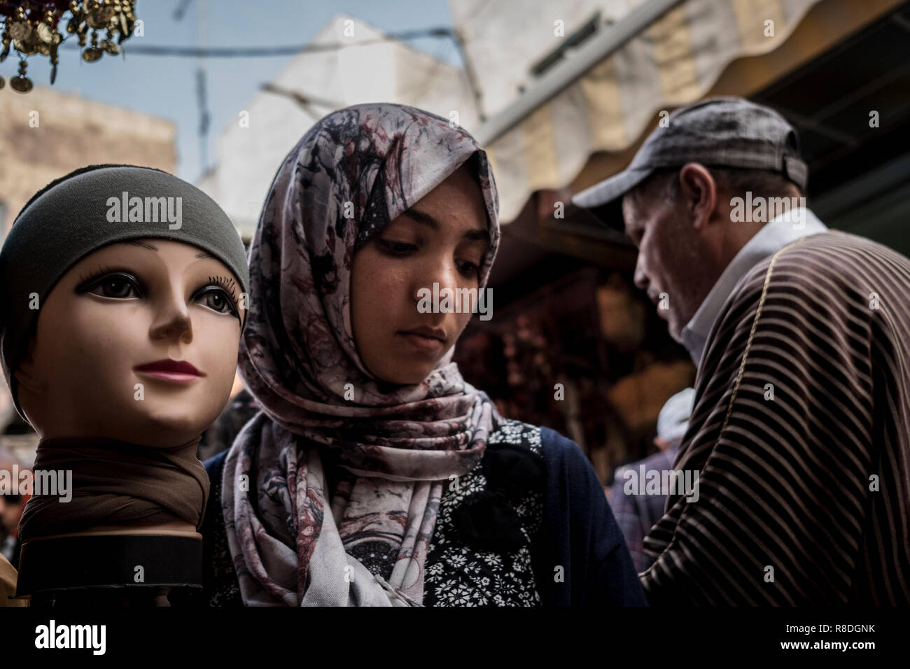 Rabat, Morocco - 24 September 2017: Woman with an hijab passing by a shop selling hijabs - Stock Image
