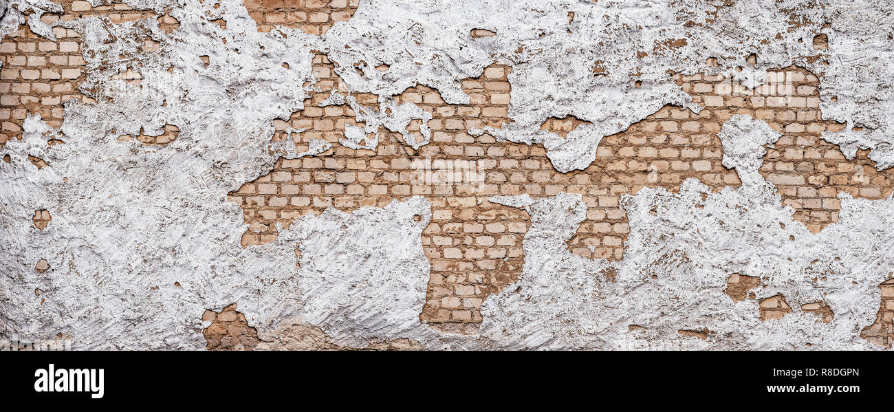 Old urban background, white ruined industrial brick wall with copy space Stock Photo