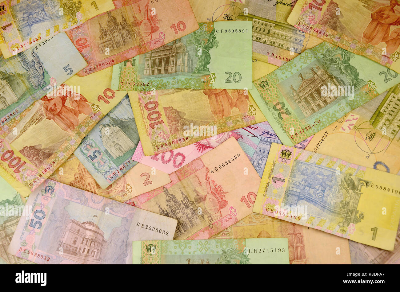 571022134b836 Background image of many Ukrainian banknotes of different colors and size.  Conceptual image for the Ukrainian banking operations