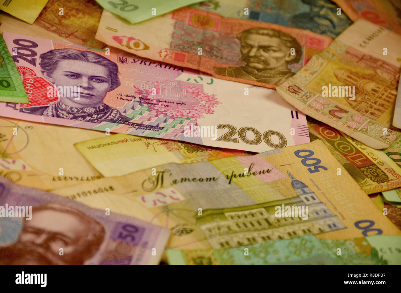 Background image of many Ukrainian banknotes of different colors and size. Conceptual image for the Ukrainian banking operations, withdraw funds, weal - Stock Image