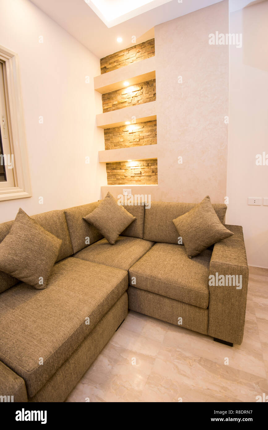 living room lounge sofa in luxury apartment show home showing interior design decor furnishing R8DRN7