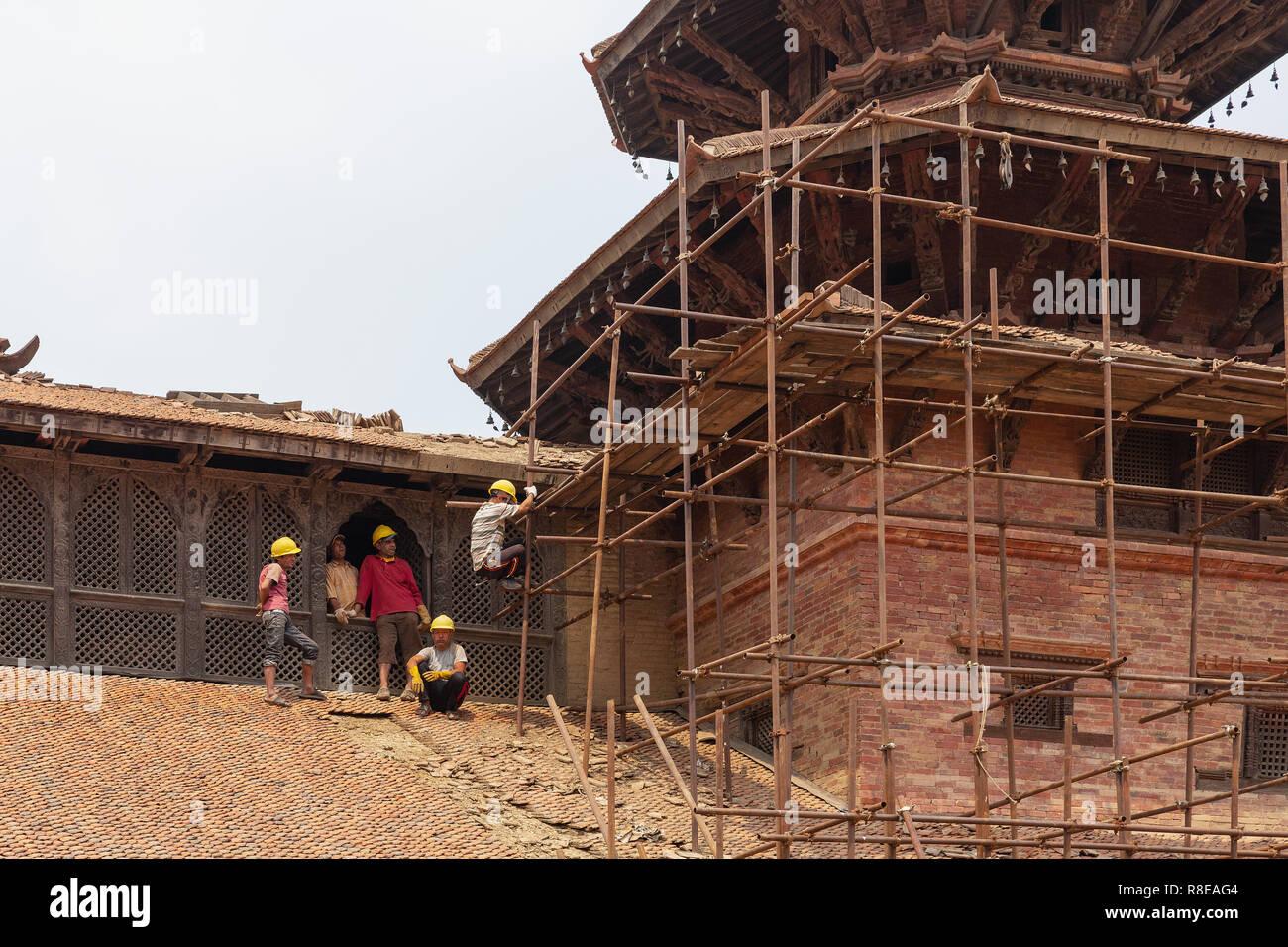 Construction scaffolding and building renovation of earthquake damage at  Hanuman Dhoka Palace Complex in Patan, Lalitpur, Nepal. Stock Photo