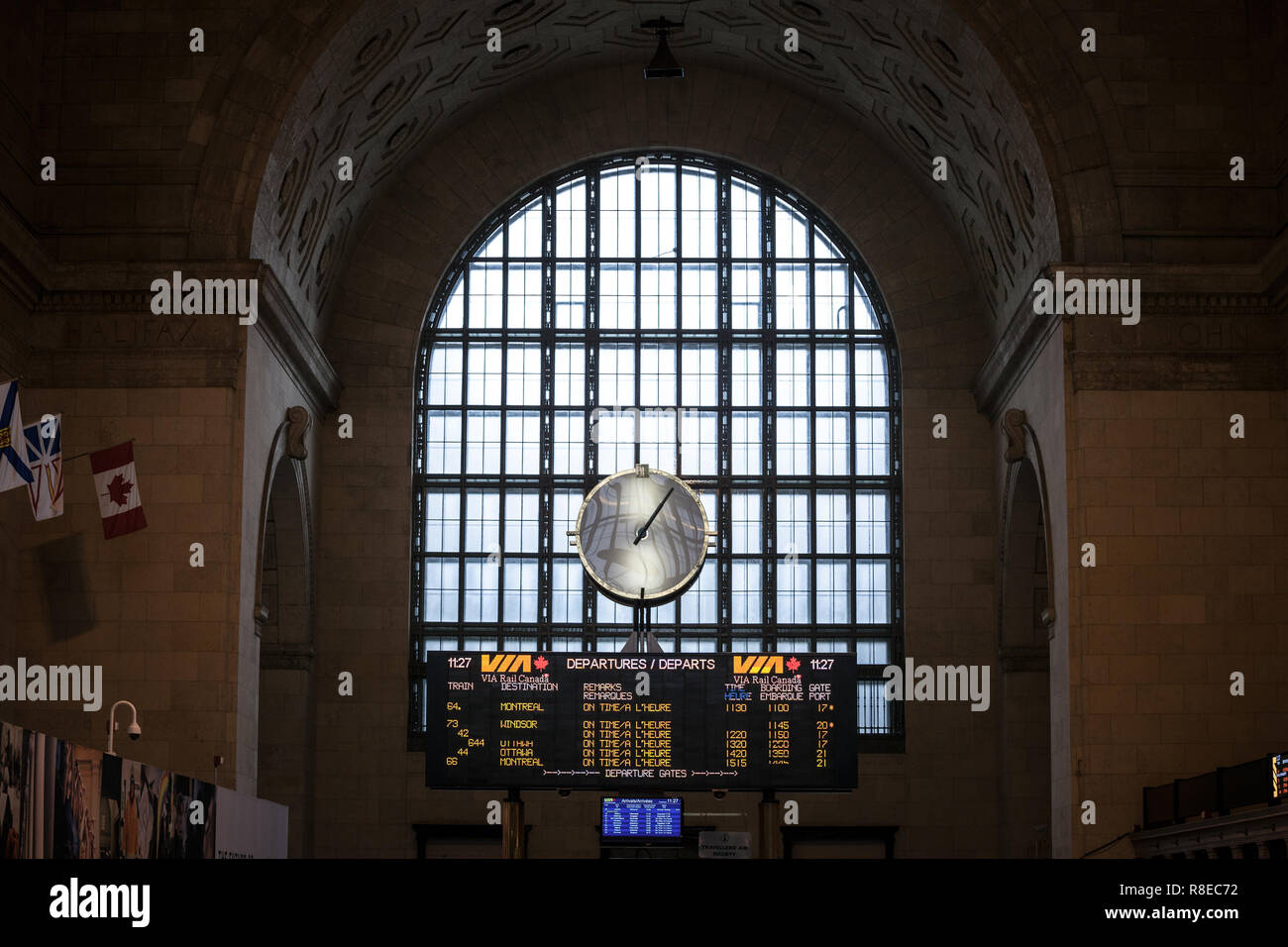 TORONTO, CANADA - NOVEMBER 13, 2018: Toronto main hall with its departures and arrivals board. It is the main railway station for Via Rail in Ontario  - Stock Image