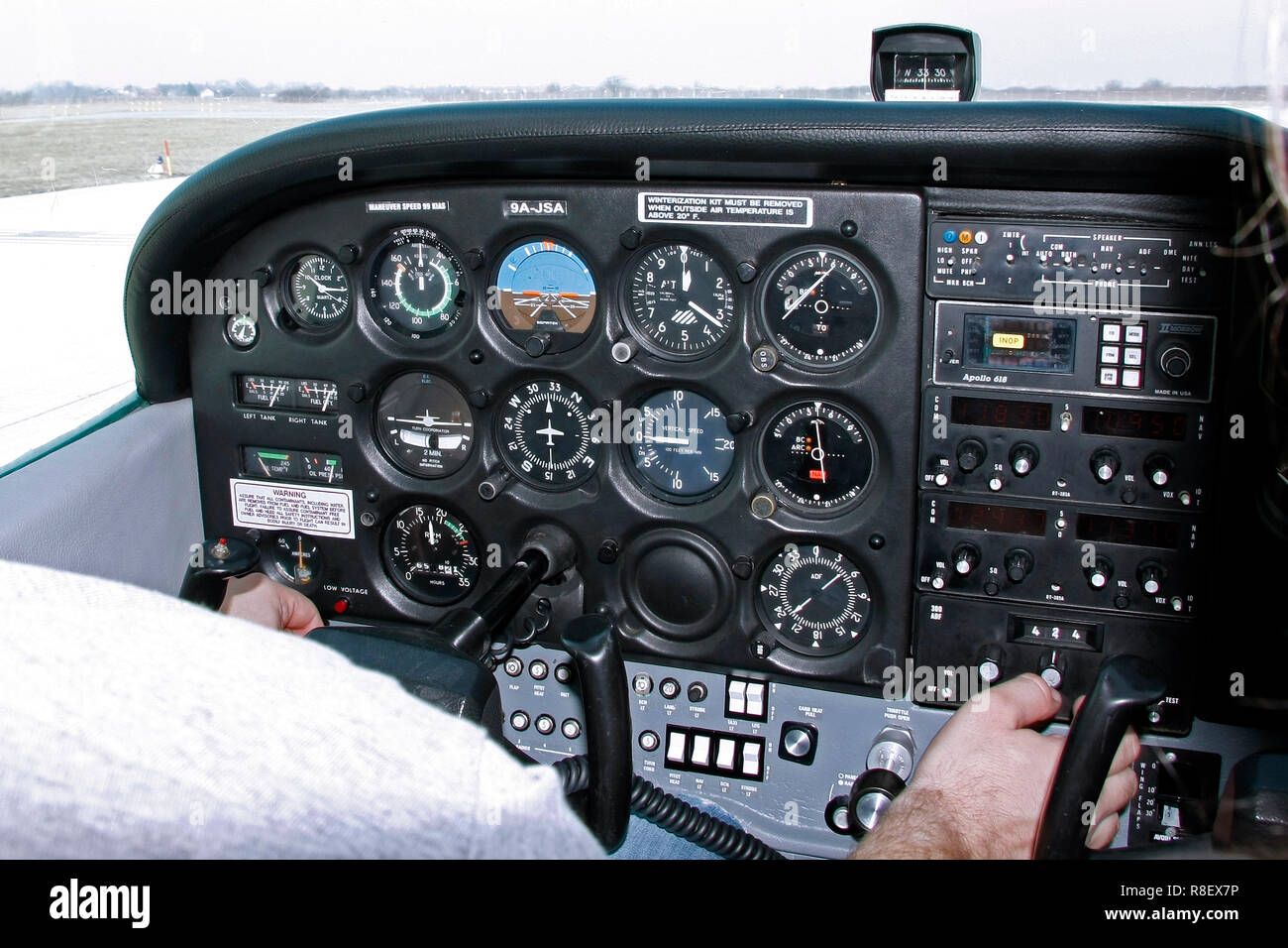 Zagreb, Croatia - February 25, 2012: Pilot cheks the instruments in the airplane before taking off - Stock Image