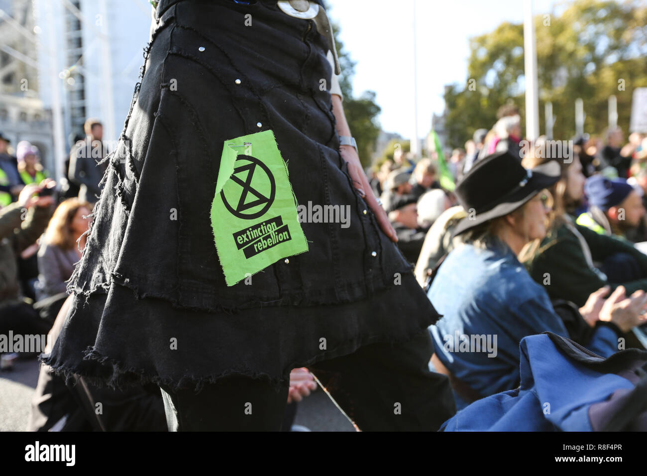 Extinction Rebellion demonstrate against climate change in Parliament square by blocking roads and locking on - Stock Image
