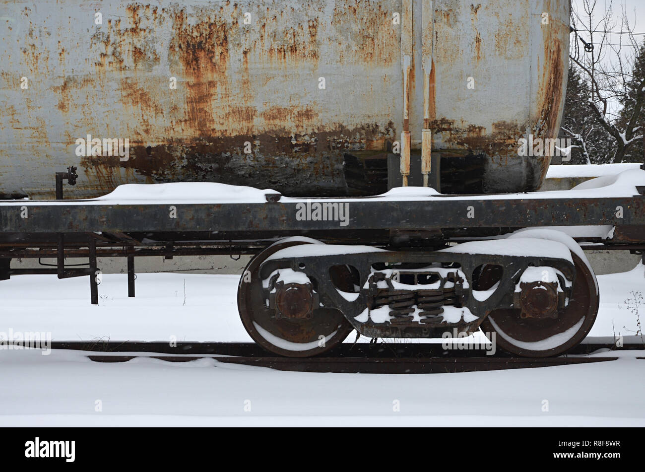 Detailed photo of snowy frozen railway freight car  A