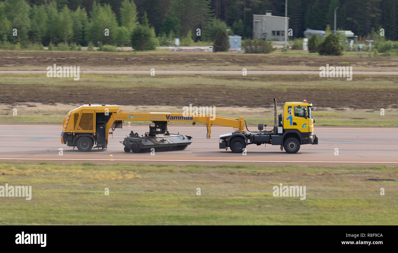 Vammas SB 4500 tow-behind sweeper clears the runway of foreign objects during an Air Show in Jyväskylä Airport at Tikkakoski, Finland. - Stock Image