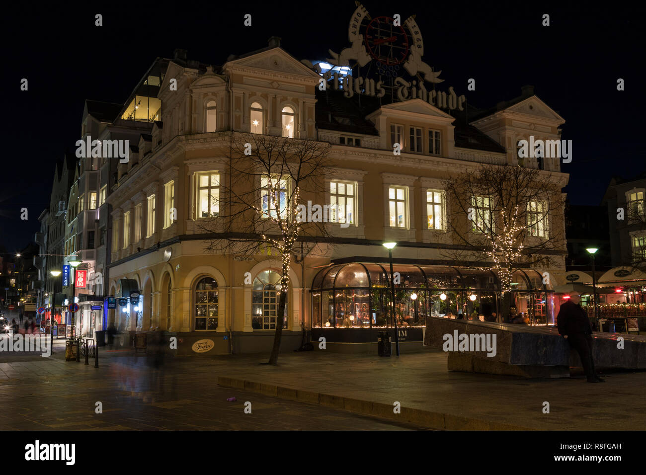 Christmas illuminated trees and building at Kong Olav Vs Plass 4 in downtown Bergen, Norway. - Stock Image