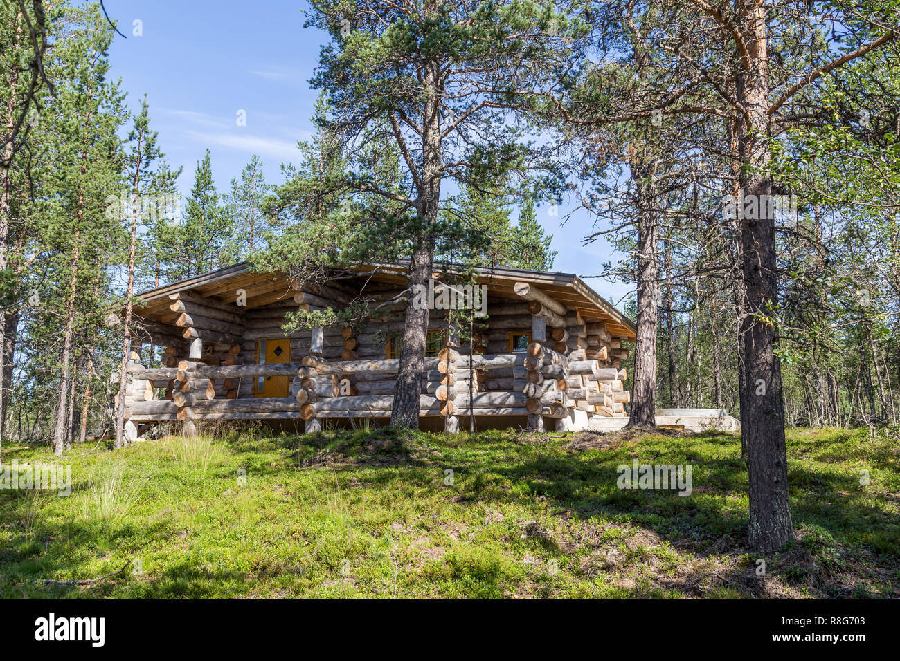 Finnish wooden loghouse in the forest of Lapland - Stock Image