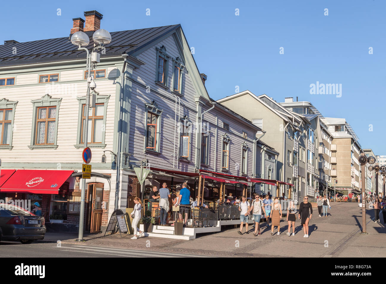 OULU, FINLAND - JULY 21, 2016: People in the centre of Oulu Finland enjoying an exceptional sunny and hot evening. - Stock Image