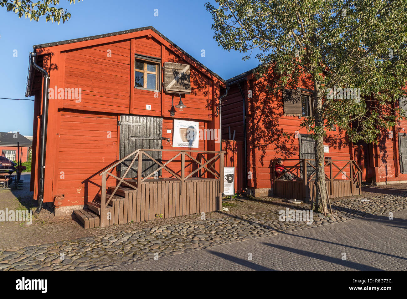 OULU, FINLAND - JULY 21, 2016:  Old wooden warehouses  in the old center around the harbor of Oulu Finland - Stock Image