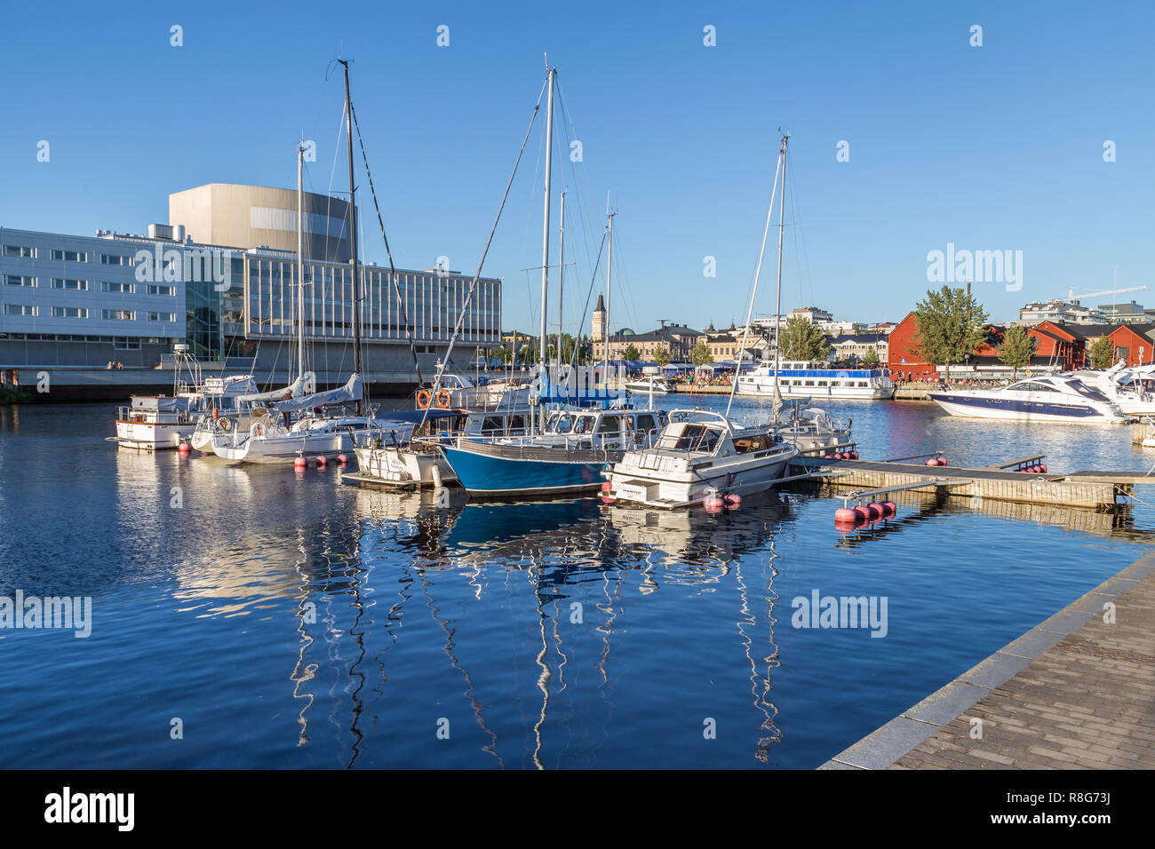 OULU, FINLAND - JULY 21, 2016: Harbor in the center of Oulu Finland during an sunny summer evening. - Stock Image