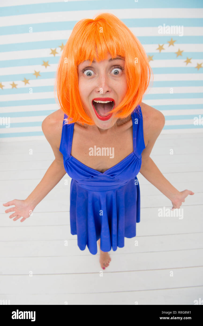 this is unbelievable. crazy girl with happy or surprise emotions on face. it looks unbelievable. crazy girl with orange hair. surprise moment. wow. what a wonderful gift - Stock Image