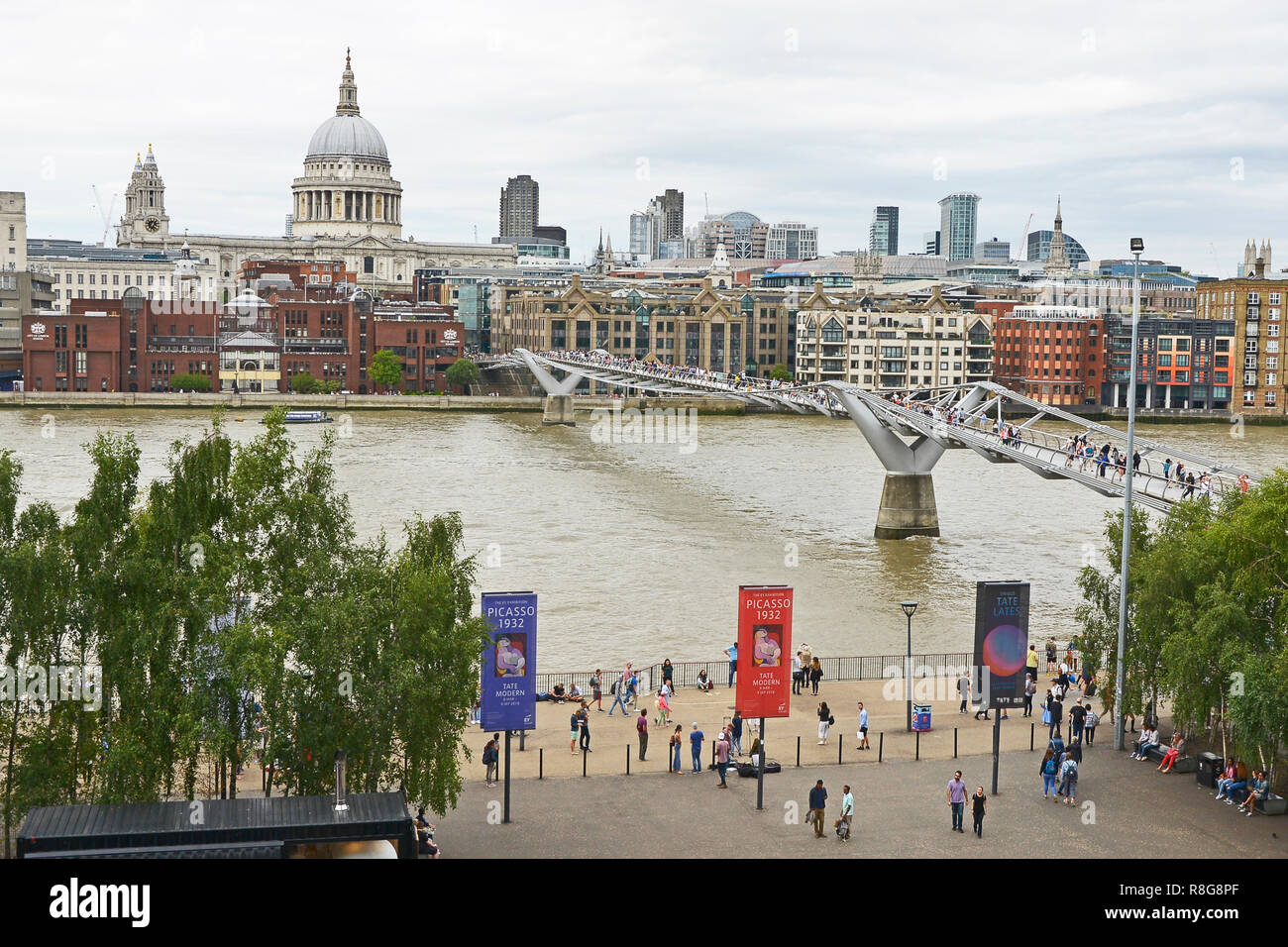 THE MILLENNIUM BRIDGE, THAMES EMBANKMENT, LONDON. AUGUST 2018. The Millennium Footbridge asuspension bridge over the River Thames with St Pauls Stock Photo