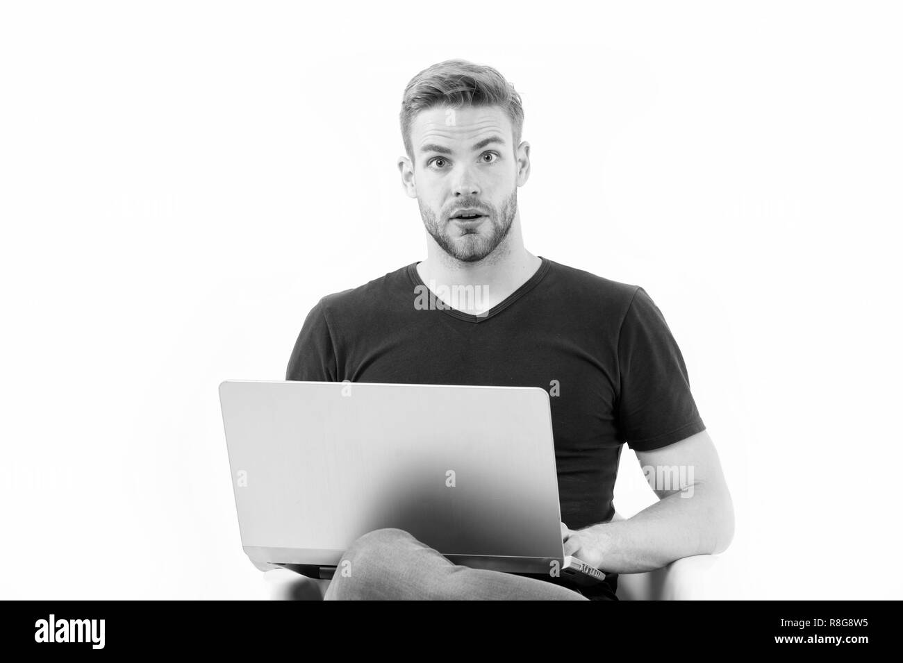 In search of inspiration. Man with laptop surprised inspired face found idea. Guy handsome unshaven in black shirt works computer isolated white. Man inspired fresh idea thought born on his mind. - Stock Image