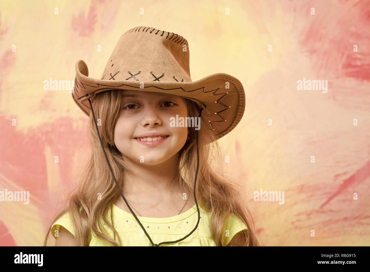 6206e2fafa545 cowgirl. little girl in cowboy hat on colorful background