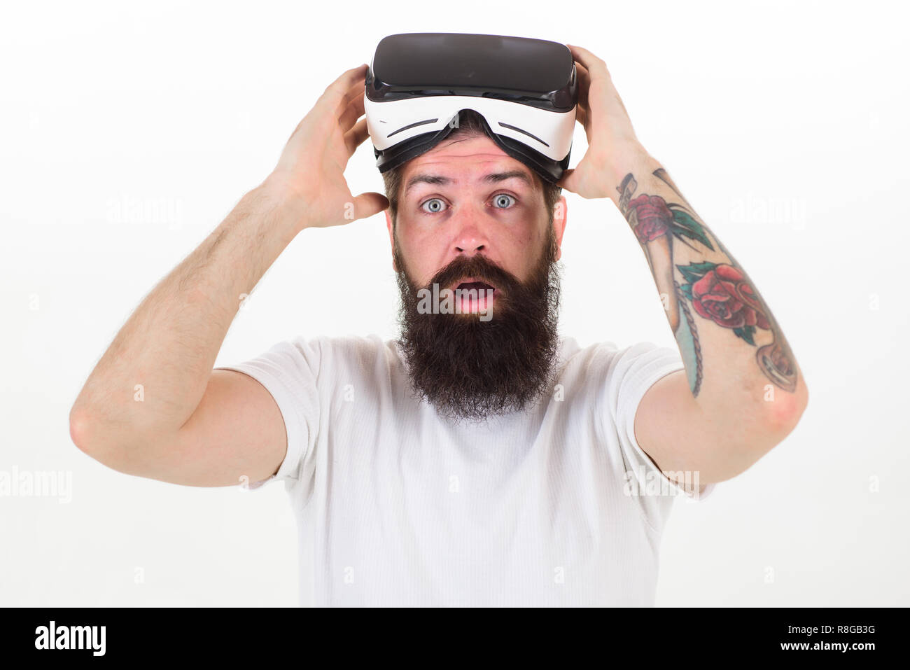 What benefits of virtual reality headset. Man bearded hipster with virtual reality headset on white background isolated. Sensational feelings of using VR headset. How virtual reality glasses work. - Stock Image
