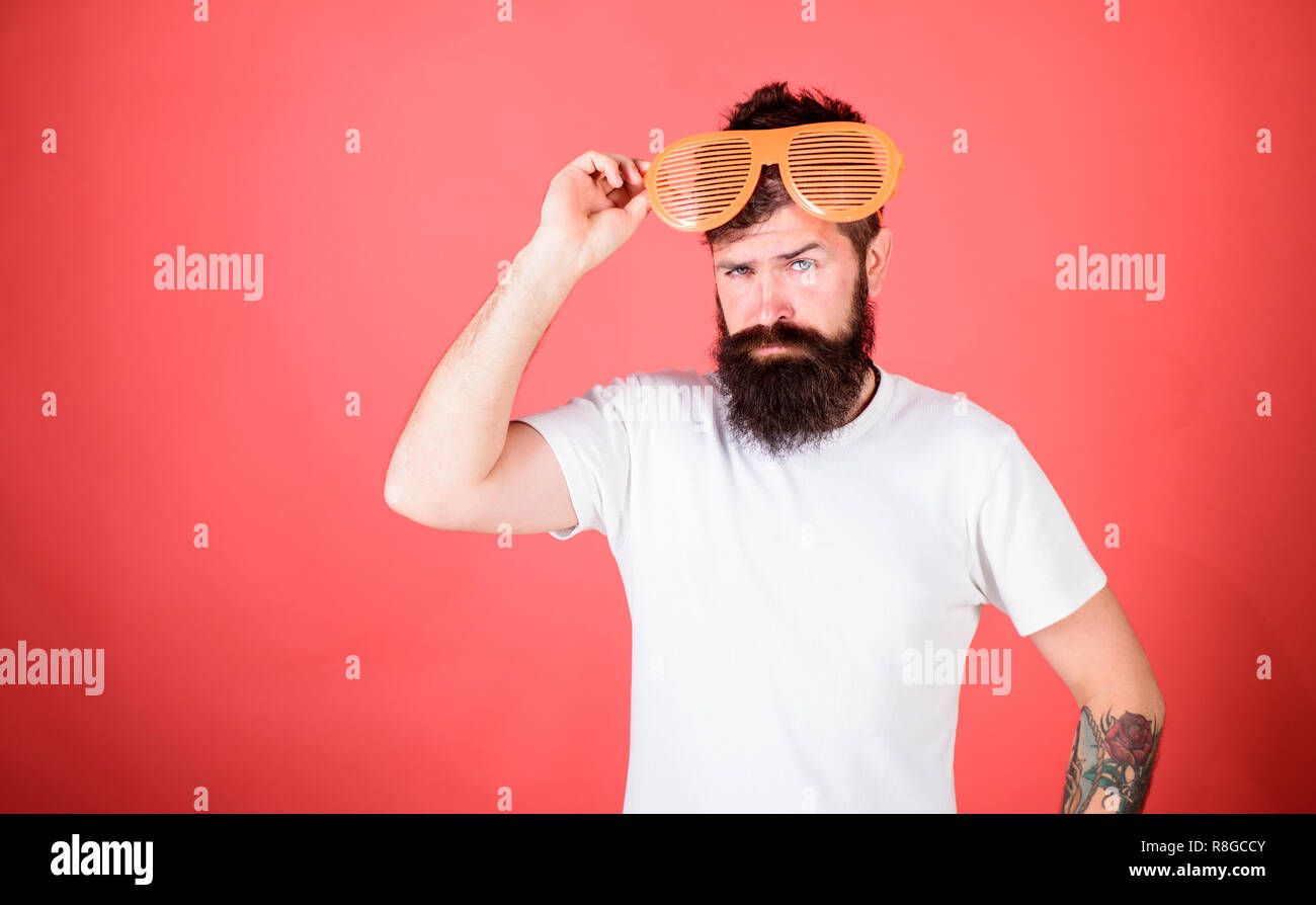Hipster wear shutter shades sunglasses. Fashionable accessory. Sunglasses party attribute and stylish accessory. Man bearded hipster wears giant louvered sunglasses. Eye protection accessory concept. - Stock Image