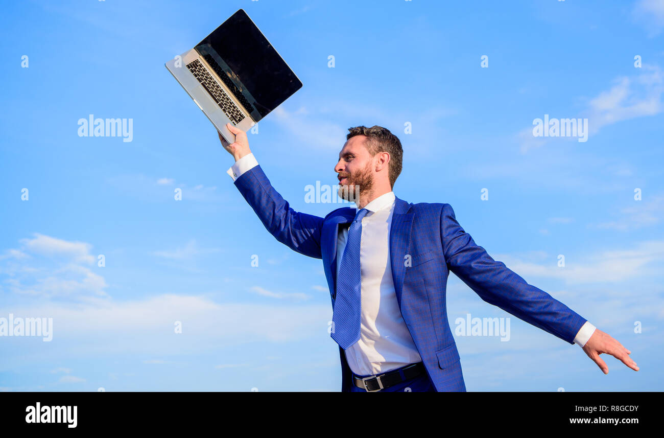 He has a dream. Businessman inspired entrepreneur feels powerful going to change world. Man inspired holds laptop above himself. Follow your interests. Businessman formal suit follow laptop. - Stock Image