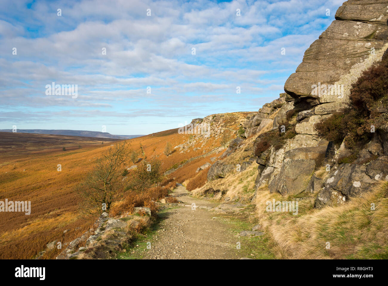 Footpath below High Neb on Stanage Edge in the Peak District national park, England. Autumn colour on the slopes. Stock Photo