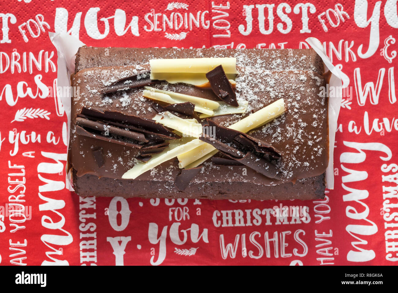 M&S Yuletide Log on Christmas serviette napkin - from above looking down on - Stock Image