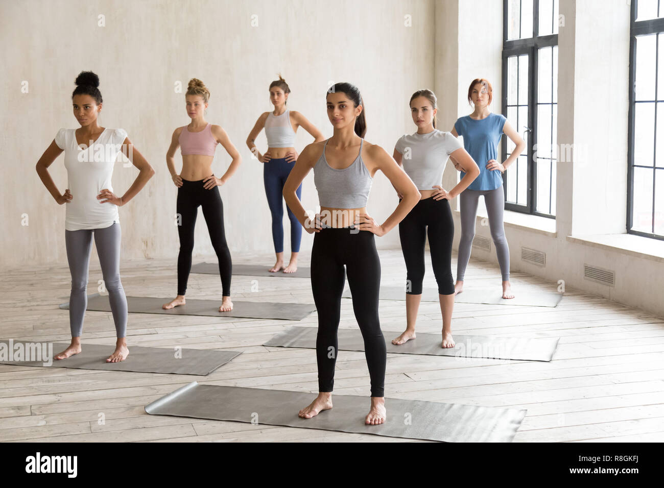 Diverse girls gathered together for yoga practising - Stock Image