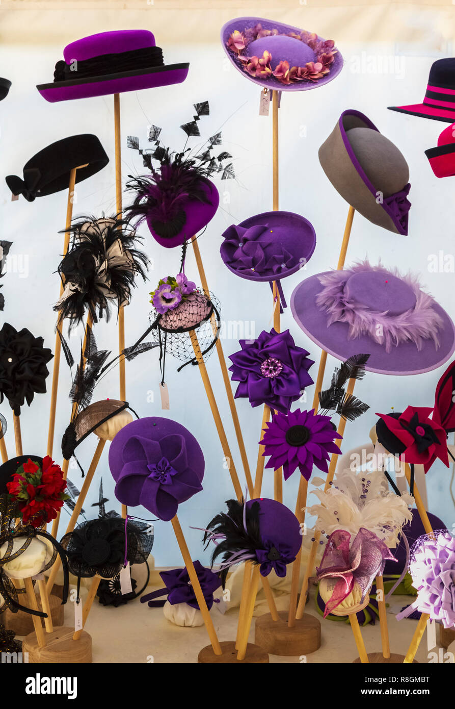 Colourful Display of Millinery at Craft Fair Held in a Marquee - Stock Image